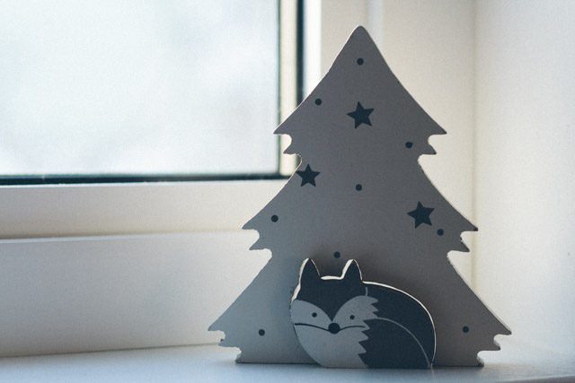 holiday decor at movita's house - a wee racoon by a wooden tree